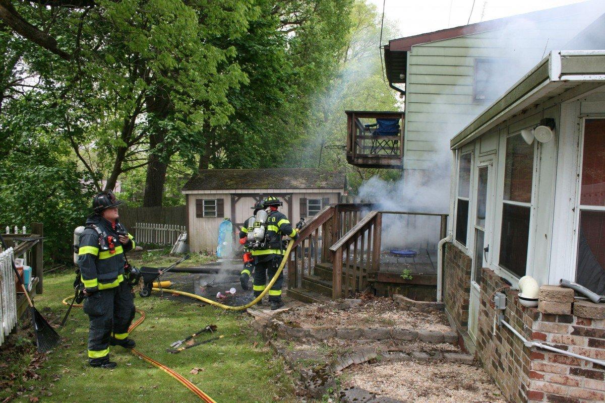 Crews extinguishing a deck fire